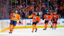 Connor McDavid (97), Oscar Klefbom (77), James Neal (18) and Ryan Nugent-Hopkins (93) of the Edmonton Oilers celebrate McDavid's goal against the Colorado Avalanche at Rogers Place in Edmonton on Thursday, Nov. 14, 2019. (THE CANADIAN PRESS/Codie McLachlan)
