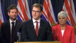 B.C. Health Minister Adrian Dix, second from left, speaks in this file photo from November 2019.