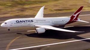 In this photo provided by Australian airliner Qantas, the Boeing 787-9 Dreamliner taxies after landing at Sydney airport in Sydney, Friday, Nov. 15, 2019. ( James Morgan/Qantas via AP)