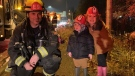 The Stanley kids with a Vancouver fire crew after the family car caught on fire.