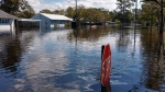 Flooding in the aftermath of Hurricane Florence overtakes the town of Pollocksville, N.C., Tuesdy, Sept. 18, 2018. (Gray Whitley/Sun Journal via AP)