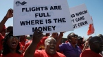 Members of the South African Cabin Crew Association and the National Union of Metalworkers of South Africa members picket at the SAA Airways Park in Kempton Park, South Africa, Friday, Nov. 15, 2019. (AP Photo/Themba Hadebe)