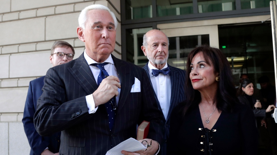 Roger Stone, left, with his wife Nydia Stone, leaves federal court in Washington, Friday, Nov. 15, 2019. Stone, a longtime friend of President Donald Trump, has been found guilty at his trial in federal court in Washington. (AP Photo/Julio Cortez)
