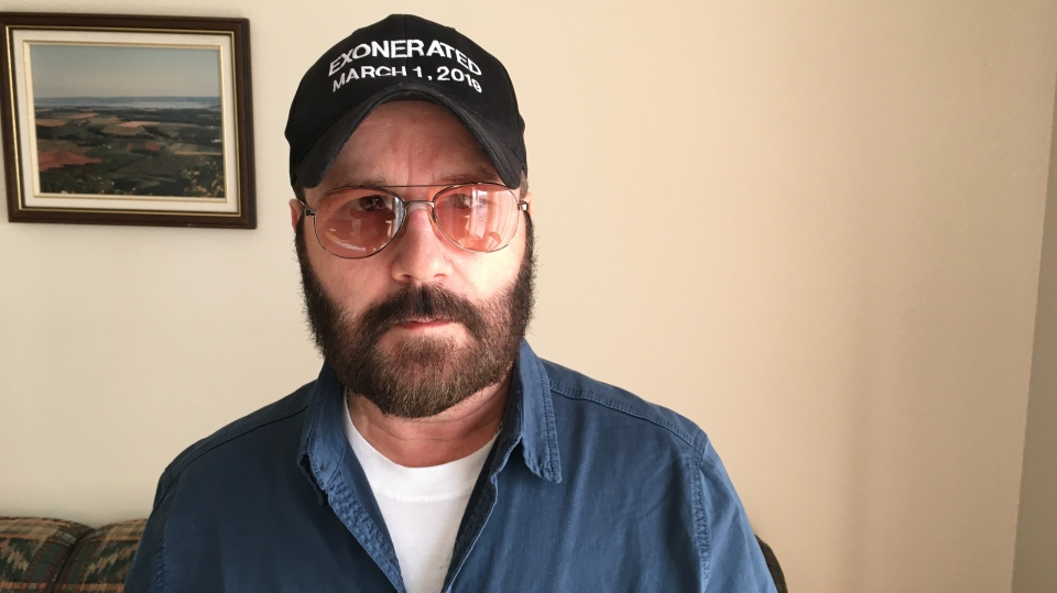 Glen Assoun can be seen wearing his new hat, which reads: 'Exonerated March 1, 2019.' (David Watt)