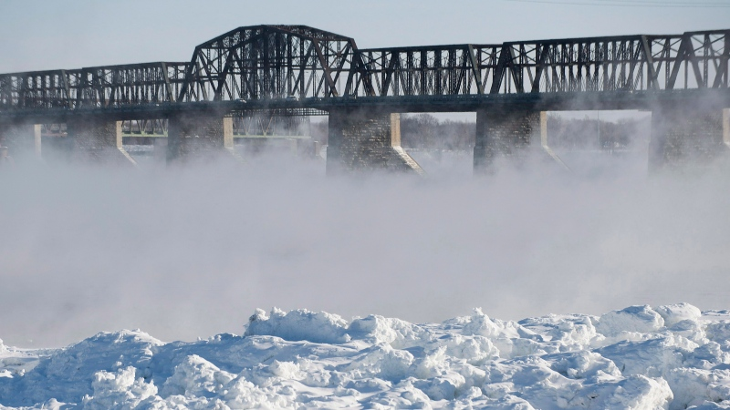 FILE: Water evaporates as it rises from the Saint Lawrence River in Montreal. THE CANADIAN PRESS/Graham Hughes