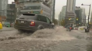 Vancouver street partially flooded by rain