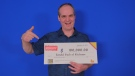 Ronald Bach, 47, posing with his lottery cheque. (Source: OLG)