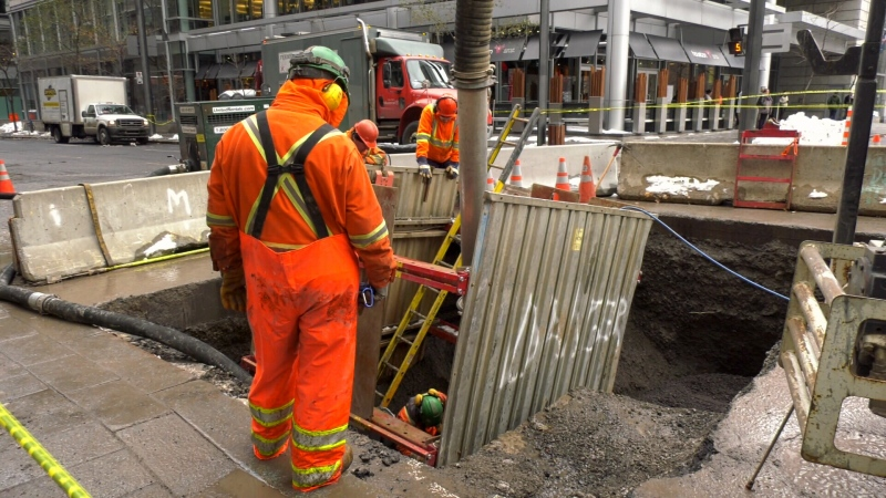 Work continues on Viger Street after a water main burst, bring metro service on the Orange Line to a halt.