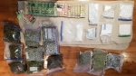 Police display drugs and Canadian currency allegedly seized during a raid on Friday. (OPP/Twitter)