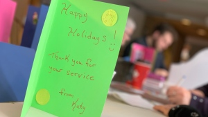 Seniors at a residence in Barrie make holiday cards to send to Canadian soldiers.