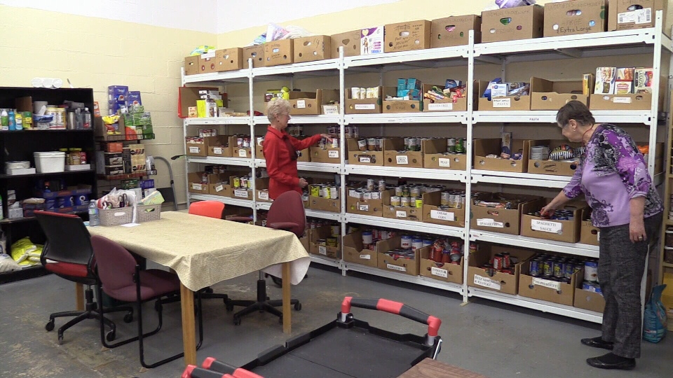 The Wasaga Beach Ministerial Food Bank volunteers sort various donations as they struggle to meet demand on Fri., Nov. 15, 2019 (CTV News Barrie)