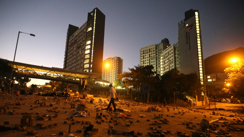 Chinese troops join Hong Kong cleanup as protesters retreat