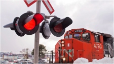 A CN locomotive moves in the railway yard in Dartmouth, N.S. on Monday, Feb. 23, 2015. Canadian National Railways conductors, trainpersons and yardpersons have given strike notice ahead of a Tuesday deadline. THE CANADIAN PRESS/Andrew Vaughan