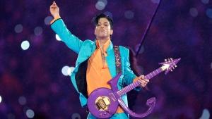 In this Feb. 4, 2007 file photo, Prince performs during the halftime show at the Super Bowl XLI football game at Dolphin Stadium in Miami. A tribute fence will be installed at Prince's famed music studio and home in Minnesota as officials prepare for fans returning on the second anniversary of the rock star's death. A three-day celebration of the late musician also will be held next month, including a concert in Minneapolis. The tribute fence will be set up inside the grounds at Paisley Park, where Prince died from an accidental painkiller overdose on April 21, 2016. (AP Photo/Chris O'Meara, File)