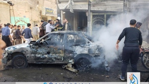 This photo provided by the Syrian anti-government activist group Albab City, which has been authenticated based on its contents and other AP reporting, people check the aftermath of a car bomb exploded in the city of al-Bab, northern Syria, Saturday, Nov. 16, 2019.  (Albab City via AP)