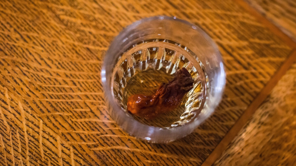 The Sourtoe Cocktail, a shot of whisky with a dehydrated human toe in the drink, is seen at the Downtown Hotel, in Dawson City, Yukon, on Sunday, July 1, 2018. THE CANADIAN PRESS/Darryl Dyck