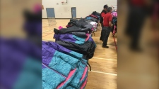 The Knights of Columbus distributed more than 600 winter coats to children in need at Bishop Kidd School Saturday.