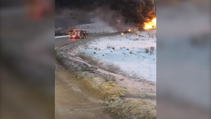 "According to the Government of British Columbia, the responding emergency officer found the truck and trailer ""mostly consumed by the fire"" upon arriving at the Pouce Coupe River bridge, about five kilometres east of Dawson Creek on Highway 49. (Courtesy: Government of British Columbia)"