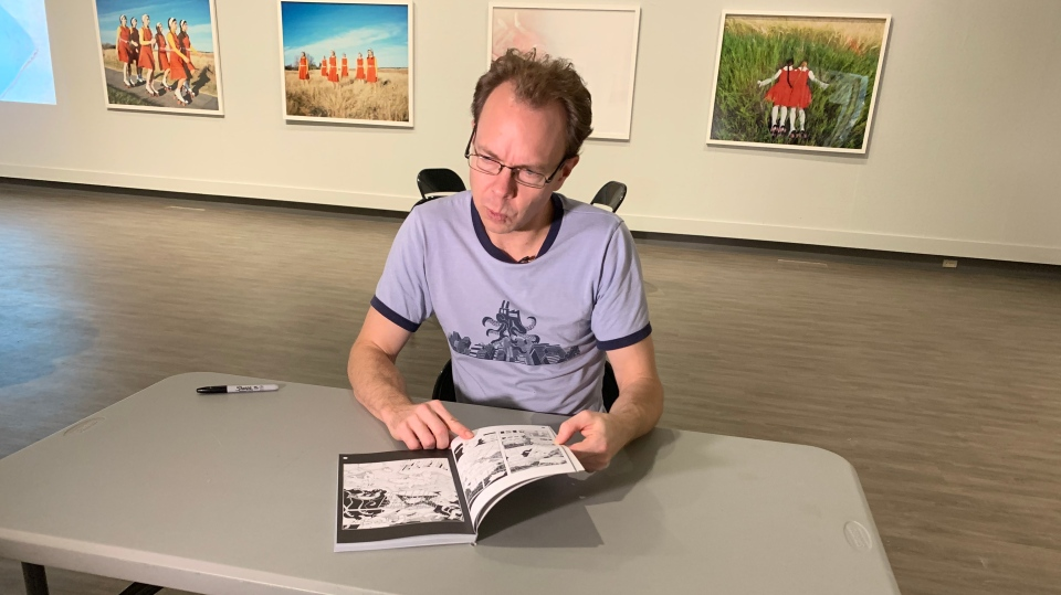 Regina artist Allan Dotson showing off his new graphic novel