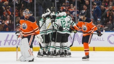 Dallas Stars players celebrate the game winning goal by Jamie Benn against the Edmonton Oilers during overtime NHL action in Edmonton on Saturday, Nov. 16, 2019. (THE CANADIAN PRESS/Jason Franson)