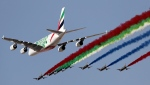 An Emirates Airline A-380 leads the 'Al Fursan', or the Knights, a UAE Air Force aerobatic display team during the opening day of the Dubai Airshow, in Dubai, United Arab Emirates, Sunday, Nov. 17, 2019. (AP Photo/Kamran Jebreili)