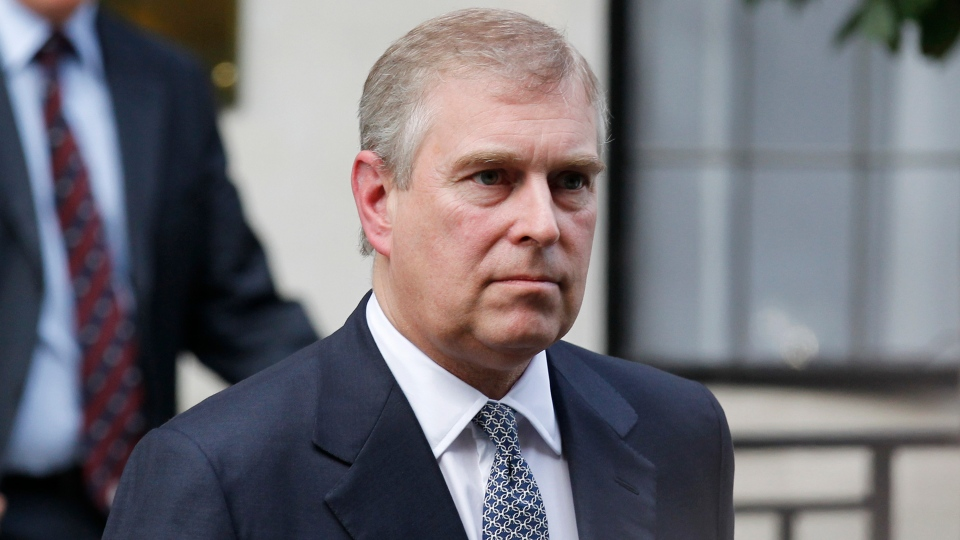 FILE- In this June 6, 2012 file photo, Prince Andrew leaves King Edward VII hospital in London after visiting his father Prince Philip. (AP Photo/Sang Tan, File)