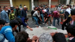 Protesters smash concrete walls set by security forces to close the Ahrar Bridge, in Baghdad, Iraq, Sunday, Nov. 17, 2019.  (AP Photo/Khalid Mohammed)