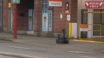 Video from the scene showed the small robot making its way up the sidewalk of Keefer Street's 100 block, near the intersection with Columbia Street. (Ben Miljure/CTV)