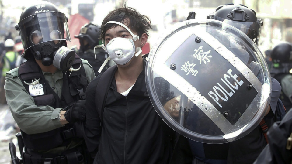 Police detain a protester in Hong Kong
