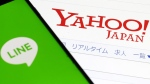 The logos of Yahoo Japan and Line Corp. (Shinji Kita / Kyodo News via AP)