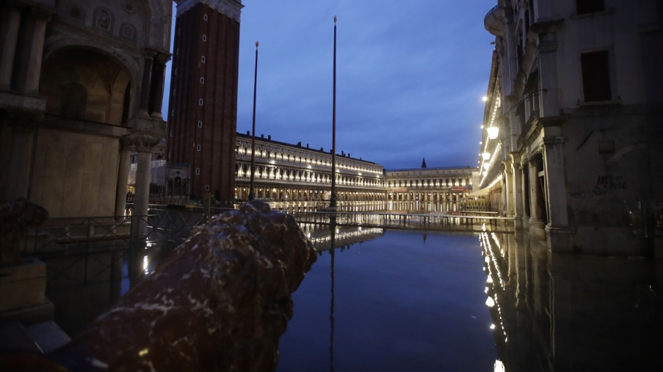 St. Mark square is reflected in flood water at dawn in Venice, Italy, on Nov. 17, 2019. (Luca Bruno / AP)