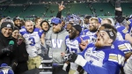 The Winnipeg Blue Bombers celebrate defeating the Saskatchewan Roughriders in the CFL West Final football game in Regina, on Nov. 17, 2019. (Jeff McIntosh / THE CANADIAN PRESS)