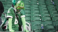 A Saskatchewan Roughriders fan reacts after his team lost to the Winnipeg Blue Bombers in Regina, on Nov. 17, 2019. (Jeff McIntosh / THE CANADIAN PRESS)