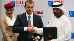 Airbus CEO Guillaume Faury, centre, shakes hands with Sheikh Ahmed bin Saeed Al Maktoum, the chairman and CEO of the Dubai-based long-haul carrier Emirates, in Dubai, on Nov. 18, 2019. (Jon Gambrell / AP)