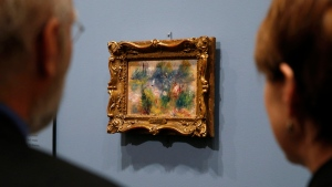 "People view Pierre-Auguste Renoir's painting ""On the Shore of the Seine"" after a news conference at the Baltimore Museum of Art in Baltimore, Thursday, March 27, 2014. (AP Photo/Patrick Semansky)"