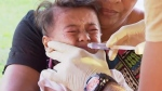 In this November 2019, image from video, a child gets vaccinated at a health clinic in Apia, Samoa. (TVNZ via AP)