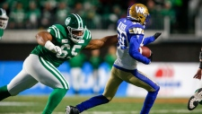 Winnipeg Blue Bombers' Winston Rose, right, runs an interception as Saskatchewan Roughriders' Terran Vaughn tries to catch him during second half CFL West Final football action in Regina, Sunday, Nov. 17, 2019.THE CANADIAN PRESS/Jeff McIntosh