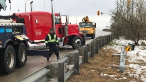 Crews work to clean up a crash and fuel leak on Highbury Avenue. (Sean Irvine / CTV London)