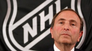 In this Sept. 13, 2012, file photo, NHL commissioner Gary Bettman listens as he meets with reporters after a meeting with team owners in New York. . (AP Photo/Mary Altaffer, File)