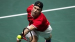 Canada's Denis Shapovalov returns the ball to Italy's Matteo Berrettini during their Davis Cup tennis match in Madrid, Spain, Monday, Nov. 18, 2019. (AP Photo/Bernat Armangue)