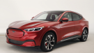 In this Wednesday, Oct. 30, 2019 photo, the new Ford Mustang Mach-E SUV is shown in Warren, Mich. Ford is hoping to score big with the electric SUV for daily drivers that sort of looks like a Mustang performance car. The new SUV, to be unveiled just ahead of the Los Angeles Auto Show press days, should have range of up to 300 miles. It's one of dozens of electric vehicles coming globally by 2022. Automakers are eyeing what they think will be a growing market in the years to come. (AP Photo/Carlos Osorio)