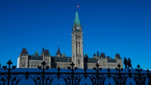 People make their way along Parliament Hill in Ottawa on Wednesday, Nov. 13, 2019. (THE CANADIAN PRESS/Sean Kilpatrick)
