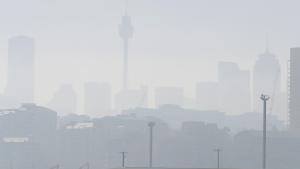 Smoke haze covers Sydney, Tuesday, Nov. 19, 2019, as wildfires burn near the city. (AP Photo/Rick Rycroft)