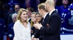 Canadian women's hockey star Hayley Wickenheiser, a member of the Hockey Hall of Fame's inductee class of 2019, is greeted by members of the Hall of Fame during a ceremony ahead of NHL hockey action between the Toronto Maple Leafs and Boston Bruins in Toronto on Friday, Nov. 15, 2019. THE CANADIAN PRESS/Frank Gunn