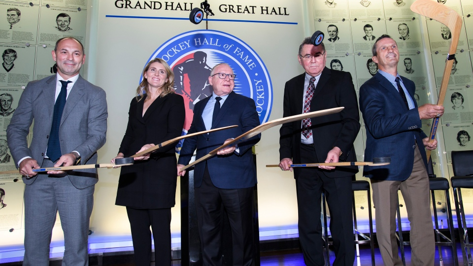 Hockey Hall of Fame inductees Sergei Zubov,left to right, Hayley Wickenheiser, Jim Rutherford, Vaclav Nedomansky and Guy Carbonneau pose for a photograph in Toronto on Friday, November 15, 2019. THE CANADIAN PRESS/Nathan Denette