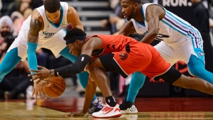Toronto Raptors guard Terence Davis (0) battles for the ball with Charlotte Hornets forward Miles Bridges, left, and forward Michael Kidd-Gilchrist (14) during second half NBA action in Toronto on Monday, Nov. 18, 2019. THE CANADIAN PRESS/Frank Gunn