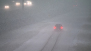 Blowing snow reduced visibility for drivers on Stoney Trail in northwest Calgary during the Tuesday morning commute