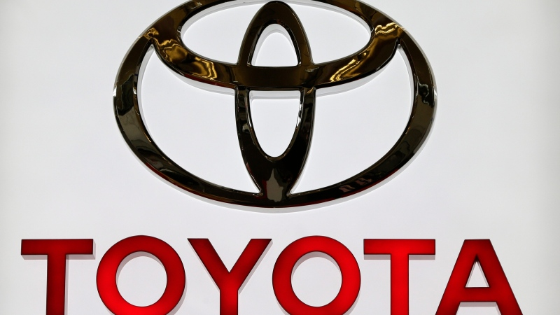 This photo taken Feb. 14, 2013, shows the Toyota logo on a sign at the Pittsburgh Auto Show in Pittsburgh. Toyota says it hopes to prevent further cases after authorities ruled that one of its engineers killed himself after being repeatedly ridiculed by his boss. The company acknowledged the case, reported Tuesday, Nov. 19, 2019. (AP Photo/Gene J. Puskar)
