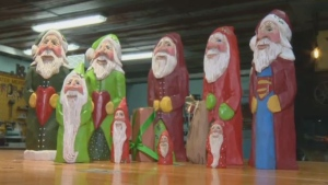 Elizabeth Brown's handmade and painted wooden Santas have become her signature pieces -- no two are the same.