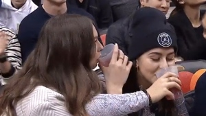 Bianca Andreescu (right) and Penny Oleksiak (left) are seen sitting courtside at the Toronto Raptors game on Nov. 18, 2019. (Twitter / @Raptors)